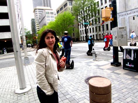 Sara in downtown Atlanta with segways